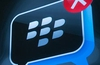 BlackBerry maker RIM reports losses but builds cash reserves