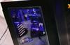 Lian Li wide-boy chassis and hinged mATX case on display